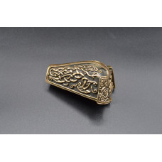Animal head brooch with knotwork